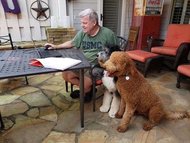 Testing positive for Covid-19 has not stopped Fayette County Administrator Steve Rapson from doing his job. Rapson continued working from home on Tuesday during quarantine, with the help of his two rescue dogs. Photo/Kristi Rapson.