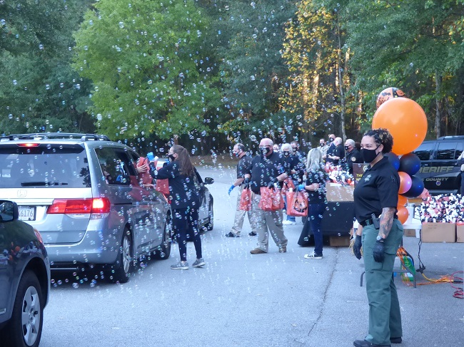 The drive-thru version of this year's Public Safety Fall Festival held Oct. 16 at the Fayette County Justice Center came with a mass of family vehicles passing through to receive goodies for kids and adults. Photo/Ben Nelms.