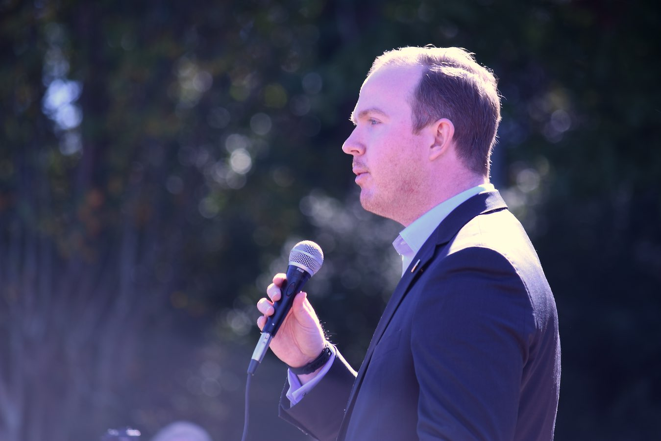 <b>White House political aide Brian Jack, a Fayette native, warms up the crowd at Saturday's rally for President Trump. Photo/Cal Beverly.</b>