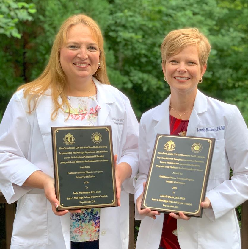 <b>Starr's Mill High School teachers Julie McKenna (L) and Laurie Davis show awards for healthcare science education industry certification. Photo/Fayette County School System.</b>