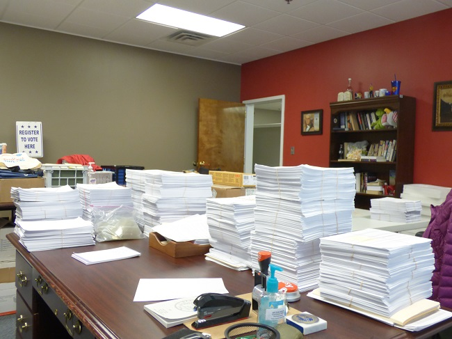 The Nov. 3 election in Fayette County will likely be historic in terms of voter turn-out. The stacks of ballots cast in-person, shown above, are but a small percentage of the total of 59,549 absentee in-person, absentee by mail and electronic ballots cast by 2 p.m. on Oct. 31. Photo/Ben Nelms.