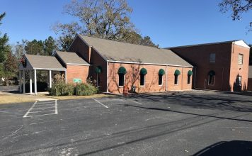A discussion by the Tyrone Town Council led to the decision to explore having the former Town Hall building on Senoia Road to serve as a museum and as a location for events or historical archives. Before it was a town hall, the building housed a United Methodist Church. The church cemetery still flanks the building. Photo/Ben Nelms.