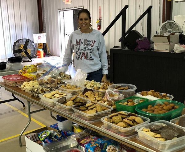 <b>Tyrone resident Theresa Clay five years ago began baking Christmas goodies and sending them to troops overseas. Her effort has blossomed as word spread through the community. Photo/Submitted.</b>