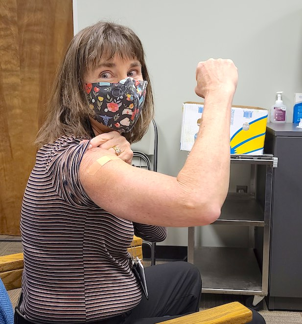 <b>Fayette County Public Schools Health Services Coordinator Debbie King proudly displays her bandage after becoming the first nurse and employee in the school system to receive the Moderna Covid-19 vaccine. Photo/Fayette School System.</b>