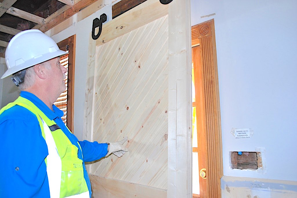 <b>Ron Brown, Senior Superintendent for Randolph Williamson, displays his handiwork on a door he fabricated to match the early 1900s era original. Photo/Submitted.</b>