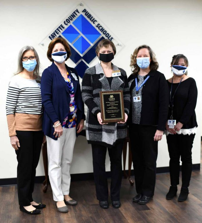 Benefits staff of the human resources department proudly display the Best in Class platinum award the department received for the school system's flexible benefits program, TOTAL Rewards. (L-R) Ronda English, Renee Hammer, Melanie Griffin, Erin Roberson, and Marie Eargle. Photo/Submitted.
