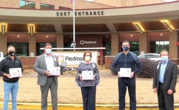 From left are Southside Church Lead Pastor (Peachtree City) Pastor Jason Dixon, Piedmont Fayette CEO Steve Porter, Piedmont Fayette Chief Nursing Officer Merry Heath, Southside Church Lead Pastor Chris Patton and Piedmont Fayette COO Nathan Nipper. Photo/Submitted.