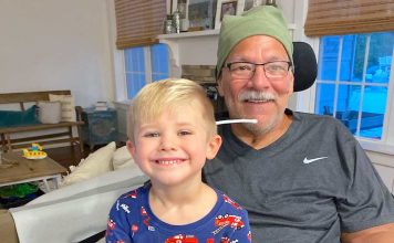 Thomas McEnhill with grandchild. Photo/Submitted.