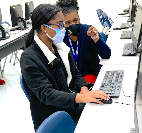 Teacher Melissa Turnipseed (right) helps student Ariana Samuels during an AP Computer Science Principles class at Sandy Creek High School.