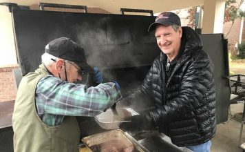 Pit masters Joe Williams and Dr. Bryan Woods hard at work. Photo/Submitted.