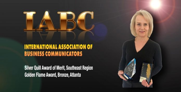 Fayette County School System Public Information Officer Melinda Berry-Dreisbach holds the IABC award. Photo/Fayette County School System.