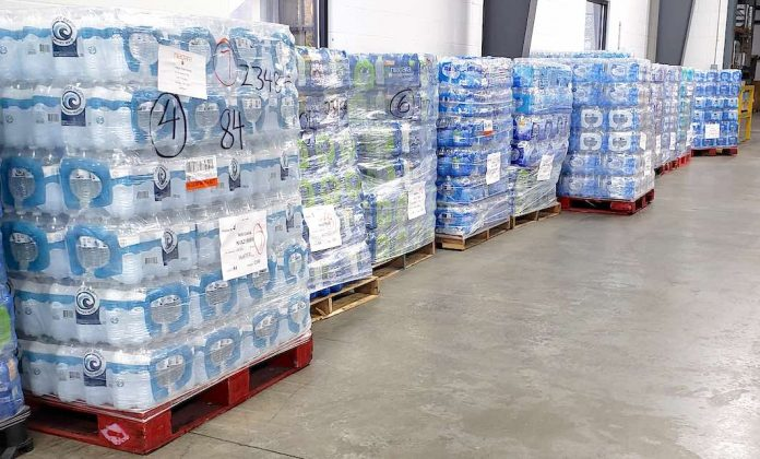 Pallets of drinking water await loading for ship to texas from the Midwest Food Bank warehouse in Peachtree City. Photo/Midwest Food Bank.