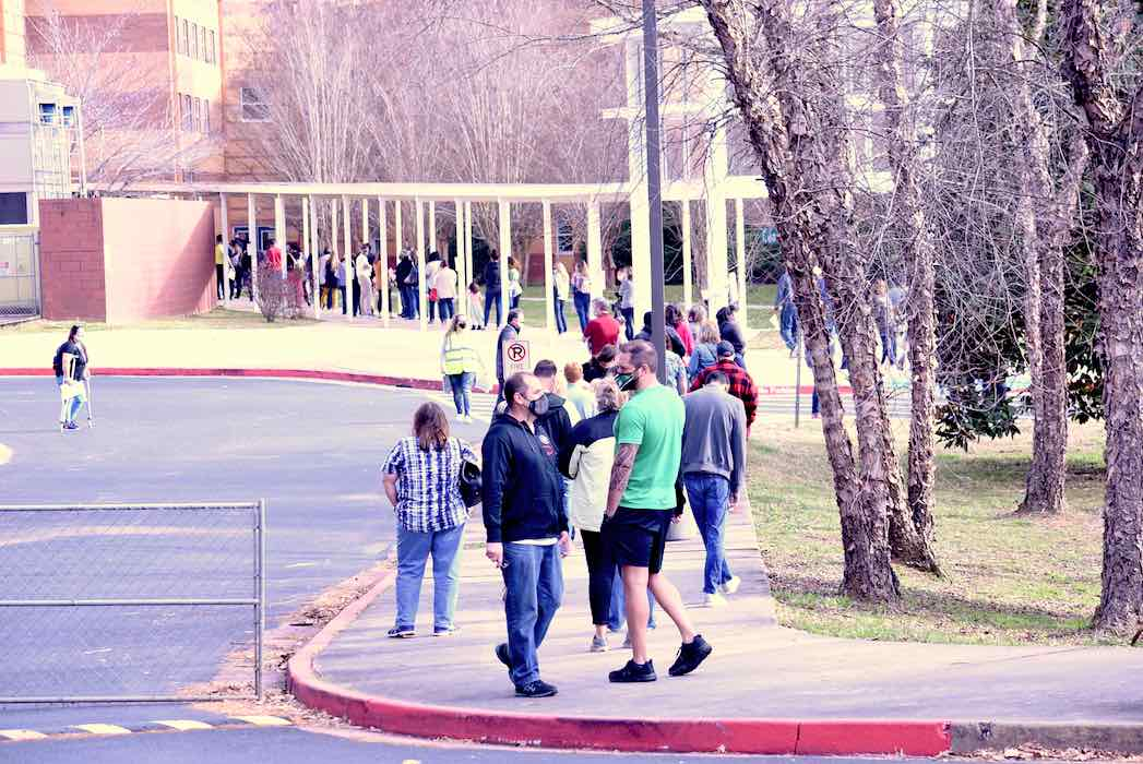 <b>Fayette School System employees lined up at 9 a.m. March 11 to await their Covid-19 initial doses. Second doses will be given in April. Photo/Cal Beverly.</b>
