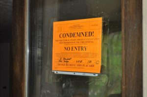 <b>Condemned sign on front of residence after cruelty to animals arrest April 8. Photo/Submitted.</b>