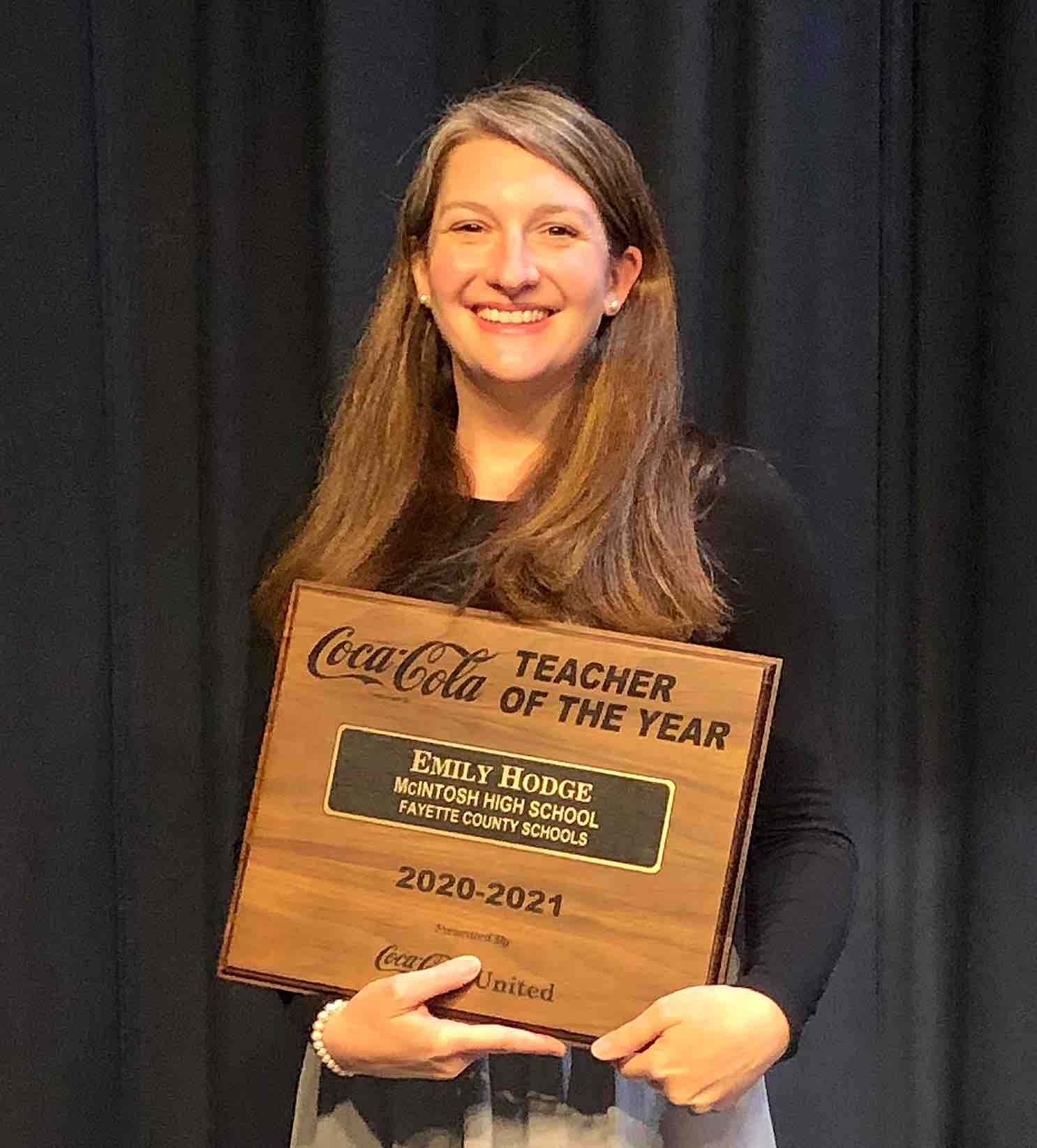 <b>McIntosh High's Emily Hodge makes history as the first media specialist ever named Fayette County Teacher of the Year. Photo/Fayette County School System.</b>