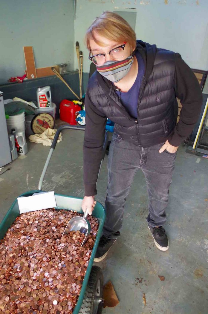 Not exactly pennies from heaven — Andreas Flaten says goodbye to the wheelbarrow full of his employer's final payment to him.Photo/Coinstar.