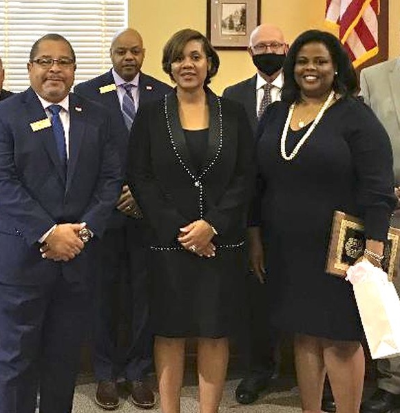 Being recognized by the Fayetteville City Council were Naihal Grant McFarlane (2nd from left) and Rhonda B. Kreuziger (at right). Photo/City of Fayetteville.