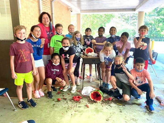 Shawn Agur's 3rd grade class enjoys their science experiment and snacks on some watermelon, too. Photo/Fayette County School System.