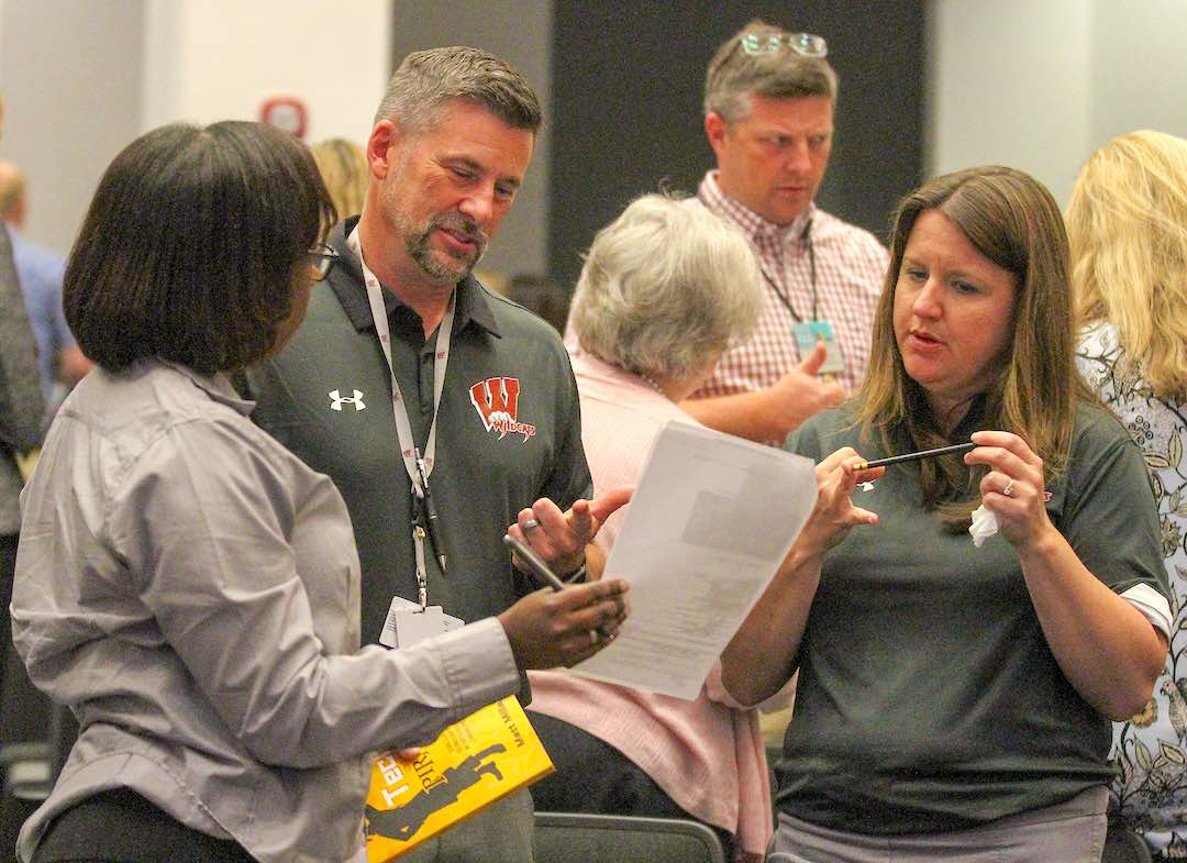 <b>Teams competed in a quiz that focused on the history of the school system and county itself. Photo/Chris Dunn.</b>