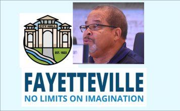 Fayetteville Mayor Ed Johnson with city's logos,
