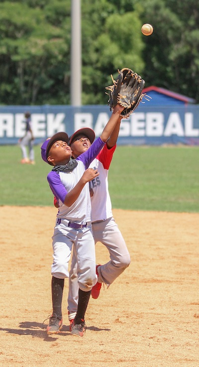 I've got this! Two future baseball stars practice for the day when a fly ball comes their way. Photo/Chris Dunn-Fayette County School System.