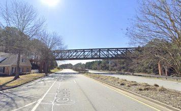 Google Street View of cart path bridge across Ga. Highway 74, looking south.