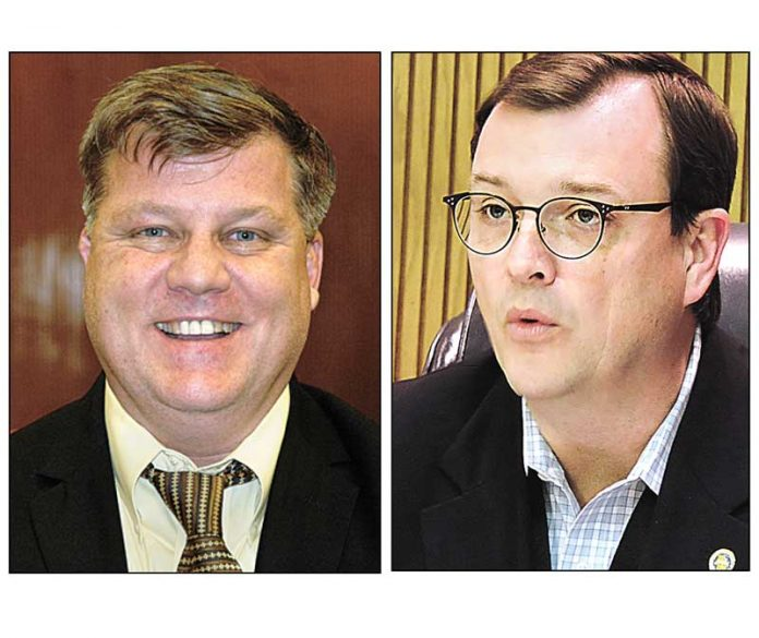 Fayette County Administrator Steve Rapson (L) and Commissioner Steve Brown. File photos.