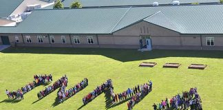 In a file photo from 2015, students line up to spell out the name of their school in Inman, south of Fayetteville.